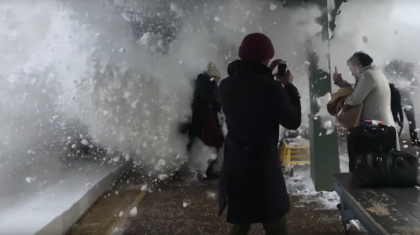 WATCH: Incredible Slow-Motion Video Captures Moment Train Covers Pedestrians in Snow