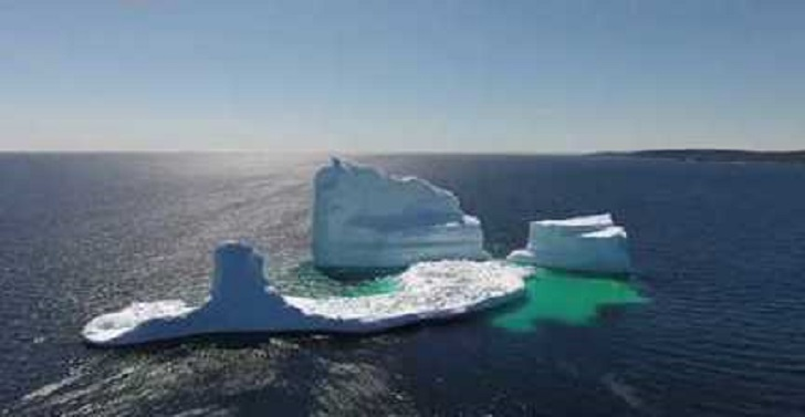Tourists Flock to See Towering Icebergs Off Newfoundland Coast