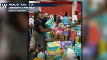 Volunteers Organize Supplies at Houston Shelter Housing Thousands