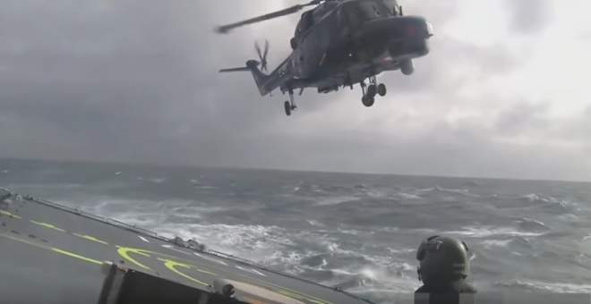 Landing A Helicopter On A Ship During A Storm Appears Near-Impossible