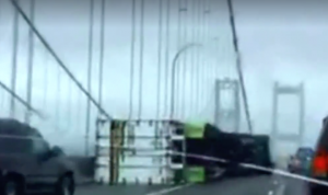 WATCH: High Winds Topple Semi on Bridge