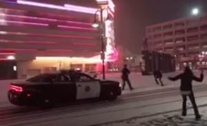 Reno Police Officer Takes a Snowball Fight Break