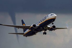 Scary Sight: Funnel Cloud Forms as Plane Takes Off